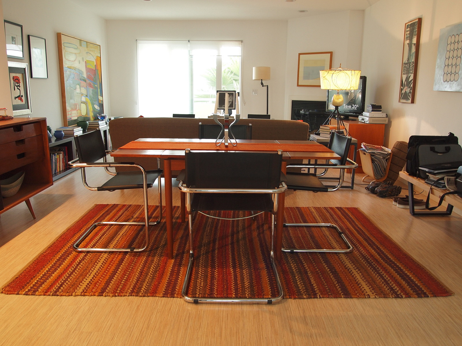 modern dining room with orange striped rug