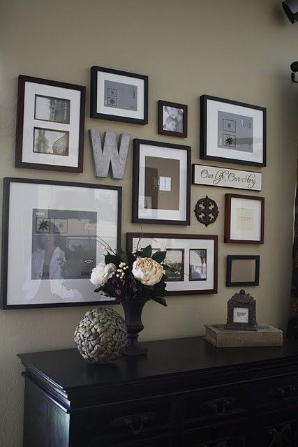 Photo gallery wall with picture frames and other items